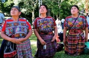 mayan women kneel